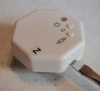 light sensor for blind and shade motor - removing the cover